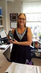 Photo: Darlene holding Garmin fitness tracker she won