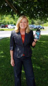 Photo: Claire holding Garmin fitness tracker she won