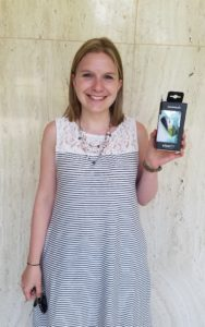 Photo: Patty holding Garmin fitness tracker she won