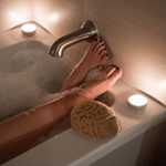 Photo: Feet propped up on the edge of the bath tub while taking a bubble bath