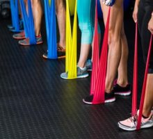 Photo: rows of feet stepping on different color resistance bands