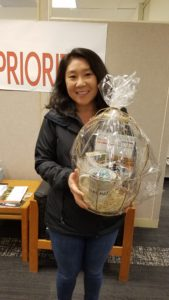 Photo: Janet Caron holding kindness gift basket