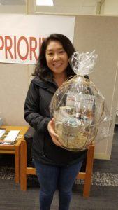 Photo: Janet Caron holding kindness gift basket