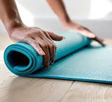 Photo: Hands rolling up a yoga mat