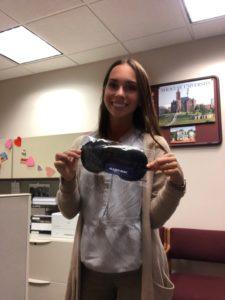 Gianna Mangicaro holding sleep mask she won